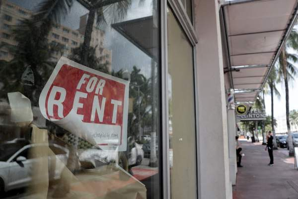 """Associated Press A """"for rent"""" sign hangs on a closed shop July13 in Miami Beach, Fla. The gross domestic product is estimated to have shrunk by an unprecedented 32.9% annual rate during the second quarter."""