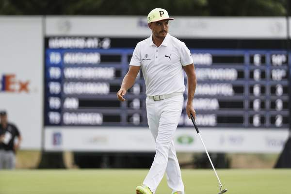 Rickie Fowler walks on the 12th green during the first round Thursday. He shot 64 and is in second place.