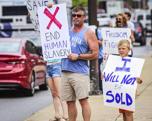 Mike Moore   The Journal Gazette People join a Hoosiers Against Human Trafficking rally Thursday along Clinton Street downtown.