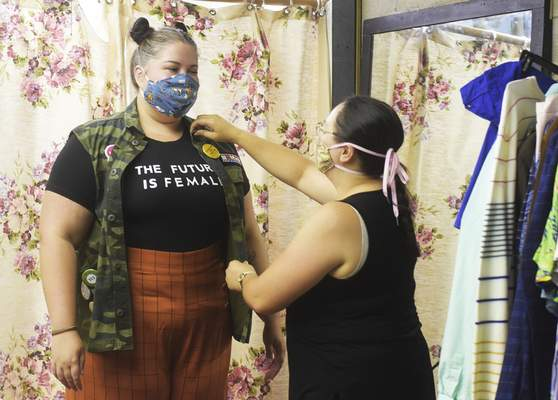 Katie Fyfe | The Journal Gazette Costume Designer and Shop Manager Angela Sahli dresses Kayley Alissa Hinen who plays Enid Hoops in Legally Blonde: The Musical before rehearsal at the Arts United Center on Monday, July 27th, 2020.