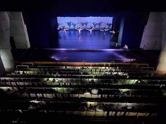 Courtesy Jeremy Springer  Audience members help light the Arts United Center after a power outage Friday morning left the theater dark during a showcase of Fort Wayne Ballet's Summer Intensive program.