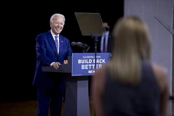 Democratic presidential candidate former Vice President Joe Biden smiles as he takes a question from a reporter at a campaign event at the William Hicks Anderson Community Center in Wilmington, Del., Tuesday, July 28, 2020.(AP Photo/Andrew Harnik)