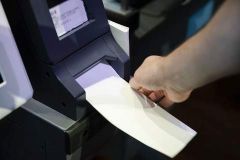 In this June 13, 2019 file photo, an Investigator with the Office of the City Commissioners, demonstrates the ExpressVote XL voting machine at the Reading Terminal Market in Philadelphia. (AP Photo/Matt Rourke, File)