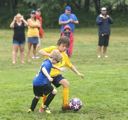 Michelle Davies   The Journal Gazette  Participants in the 8and Under scrimmage fight for control of the soccer ball during Saturday's DaMarcus Beasley Kick for a Cause fundraiser.