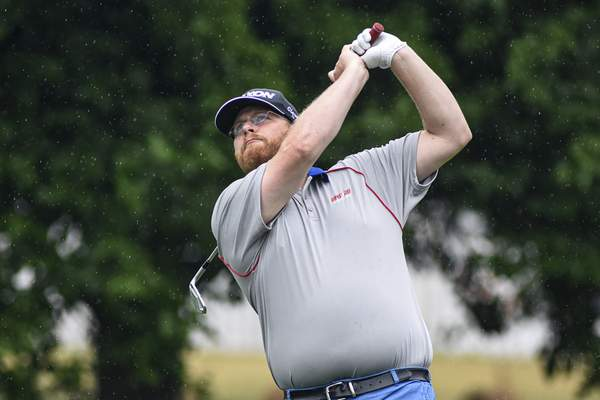 Mike Moore | The Journal Gazette Travis Hemsoth tees off while competing in round one of the City Golf Tournament at Coyote Creek Golf Club on Saturday.