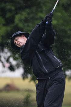 Photos by Mike Moore | The Journal Gazette Bradley Hardin shakes off rain during a swing Saturday during the first round of the Men's City Golf Championship at Coyote Creek Golf Club.