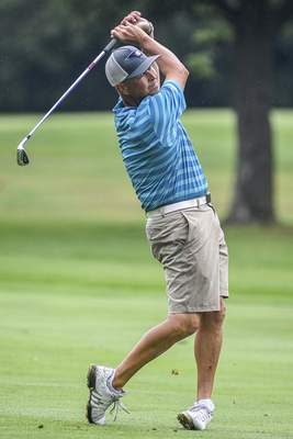 Mike Moore | The Journal Gazette Kevin Irons competes in round one of the City Golf Tournament at Coyote Creek Golf Club on Saturday.