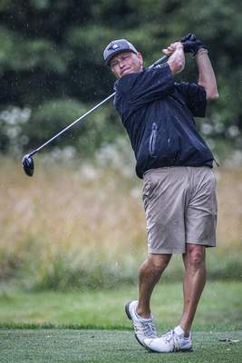 Mike Moore | The Journal Gazette Kevin Irons tees off while competing in round one of the City Golf Tournament at Coyote Creek Golf Club on Saturday.