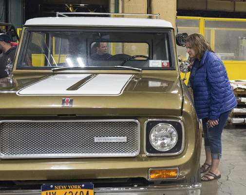 Michelle Davies | The Journal Gazette Elizabeth Terrill of Kalamazoo, Mich., checks out a SR2 190 Scout at Scout Park Conference Center on Saturday during Harvester Homecoming 2020. The event continues today for truck owners. See Page 1C.