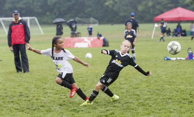 Michelle Davies | The Journal Gazette Players fight for control of the soccer ball during Saturday's DaMarcus Beasley Kick for a Cause fundraiser.