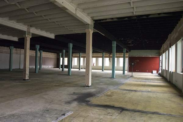 Michelle Davies | The Journal Gazette Original brick work and timbers have been incorporated into the STEAM School space planned at the Electric Works project.