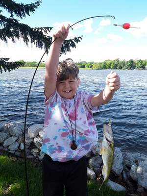 Patrick O'Rourke, 7, from Fort Wayne, caught a smallmouth bass on May 30 at his grandfather's lake cottage on Sylvan Lake in Rome City.