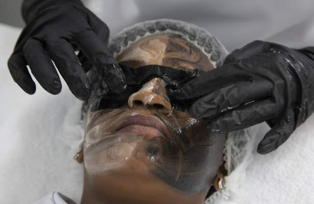 Associated Press photos Skin lightening treatments are applied to the face during a demonstration at the Skin and Body International Centre in Lenasia, Johannesburg. Cosmetics giants  are re-branding skin lightening products in Africa, Asia and the Middle East.