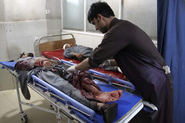A wounded man receives treatment at a hospital after a suicide car bomb and multiple gunmen attack in the city of Jalalabad, east of Kabul, Afghanistan, Sunday, Aug. 2, 2020. (AP Photo)