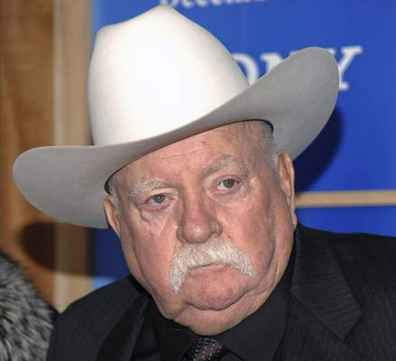 FILE - In this Monday, Dec. 14, 2009 file photo, Actor Wilford Brimley attends the premiere of 'Did You Hear About The Morgans' at the Ziegfeld Theater in New York. (AP Photo/Evan Agostini, File)