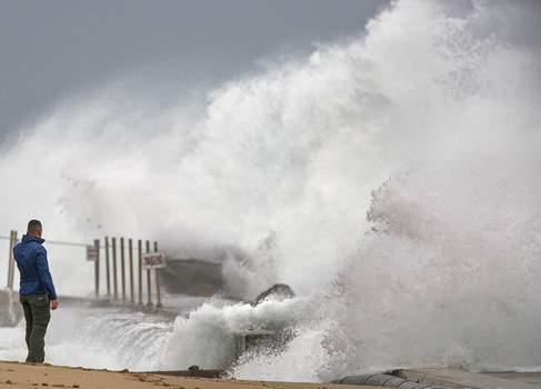 Tropical Weather Florida Associated Press Tall waves driven by Tropical Storm Isaias crash Sunday over the jetty on the north side of the Palm Beach Inlet in Palm Beach Shores, Fla. (Lannis WatersMBR)