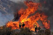 California Wildfires Associated Press Firefighters watch the Apple fire in Banning, Calif., on Sunday. (Ringo H.W. ChiuFRE)