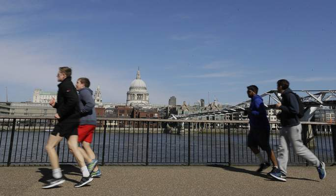Associated Press People are seen running in March alongside the River Thames in London. European Union regulators said Tuesday they're opening an in-depth investigation into U.S. tech giant Google's plan to buy fitness tracking device maker Fitbit.