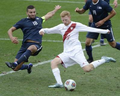 Virus Outbreak-College Sports Soccer FILE - In this Nov. 6, 2017, file photo, Indiana's Cory Thomas (11) kicks the winning goal past Penn State's Dani Marks (18) during overtime in a Big Ten NCAA college soccer match in Bloomington, Ind. (Chris Howell/The Herald-Times via AP, File) (Chris Howell MBR)