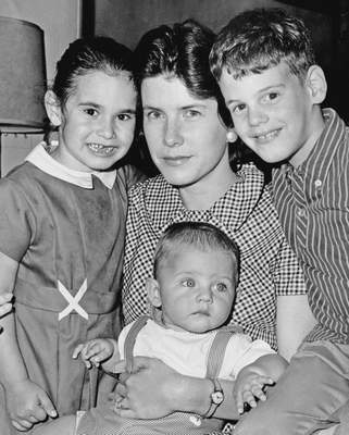FILE - In this May 3, 1965, file photo, Shirley Ann Grau, winner of a Pulitzer for her third novel The Keepers of the House, is shown in New Orleans, with her children, Nora, 5, William, 6 months, and Ian, 8. Grau, a Pulitzer Prize-winning fiction writer whose stories and novels told of both the dark secrets and the beauty of the Deep South, has died at age 91. (AP Photo, File)