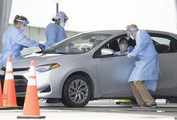 Virus Outbreak Florida Associated Press  Healthcare workers gather information before conducting a COVID-19 testWednesday outside Hard Rock Stadium in Miami Gardens, Fla. (Wilfredo LeeSTF)