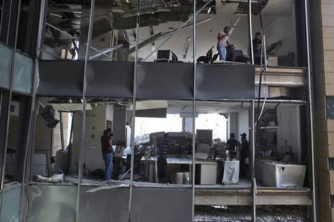 Lebanon Explosion People stand inside a damaged building near the site of an explosion on Tuesday that hit the seaport of Beirut, Lebanon, Thursday, Aug. 6, 2020. (AP Photo/Bilal Hussein) (Bilal Hussein STF)