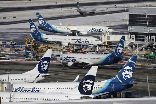 US Alaska Airlines Job Cuts Associated Press Alaska Airlines said over 300 employees in Anchorage may lose their jobs on Oct. 1.  (Ted S. WarrenSTF)