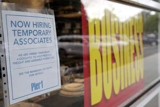 Virus Outbreak Florida Associated Press A sign advertises hiring of temporary associates at a Pier 1 store, which is going out of business, on Thursday in Coral Gables, Fla. The home goods retailer  is permanently closing all of its stores.  (Lynne SladkySTF)