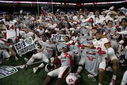 In this Dec. 7, 2019, file photo, members of the Miami of Ohio team pose on the field after the Mid-American Conference championship NCAA college football game against Central Michigan, in Detroit. (AP Photo/Carlos Osorio, File)