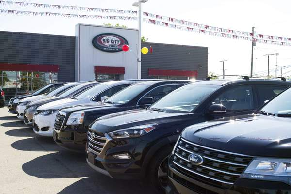 Photos by Michelle Davies | The Journal Gazette  Big City Cars on Lima Road has seen an surge in sales in recent months.