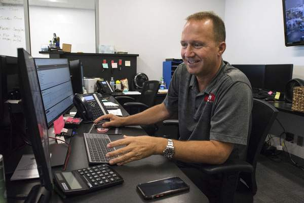 Bob Bolen, president of Big City Cars, looks online for used cars to buy to bolster his stock.