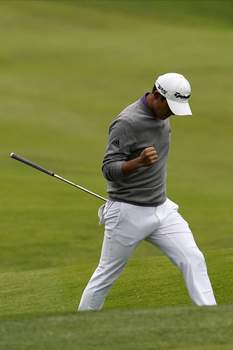 PGA Championship Golf Associated Press photos Collin Morikawa celebrates after a birdie on the 14th hole during the final round of the PGA Championship on Sunday at TPC Harding Park in San Francisco.  (Jeff ChiuSTF)