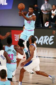 Pacers Heat Basketball Miami Heat forward Jimmy Butler (22) makes a jumping pass against the Indiana Pacers during the second half of an NBA basketball game Monday, Aug. 10, 2020, in Lake Buena Vista, Fla. (Kim Klement/Pool Photo via AP) (Kim Klement POOL)