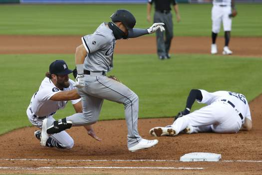 White Sox Tigers Baseball Detroit Tigers pitcher Daniel Norris, left, dives to tag out Chicago White Sox's Danny Mendick, center, as first baseman C.J. Cron (26) lies injured on the field in the fourth inning of a baseball game in Detroit, Monday, Aug. 10, 2020. (AP Photo/Paul Sancya) (Paul Sancya STF)