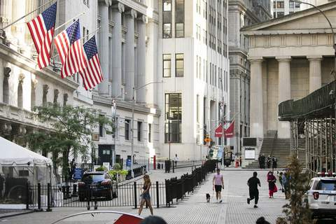 Financial Markets Wall Street FILE - People walk by the New York Stock Exchange, left, Tuesday, July 21, 2020. Wall Street is drifting in early trading on Monday, Aug. 10, after President Donald Trump announced several stopgap moves to aid the economy. (AP Photo/Mark Lennihan) (Mark Lennihan STF)