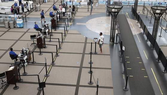 Air Travel Guns FILE - A lone traveler heads to the north security checkpoint in the main terminal of Denver International Airport Wednesday, July 22, 2020, in Denver. (AP Photo/David Zalubowski) (David Zalubowski STF)