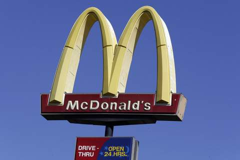 Earns McDonalds FILE - This Oct. 17, 2019 file photo shows a McDonald's sign along Interstate 40/85 in Burlington, N.C. (AP Photo/Gerry Broome, File) (Gerry Broome STF)
