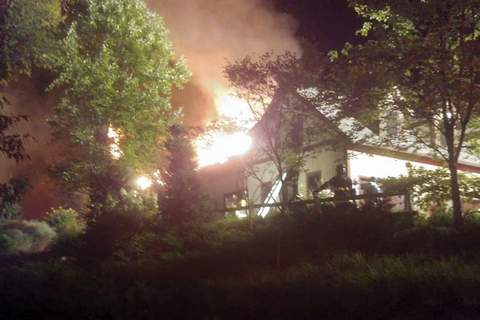 In this Sunday, Aug. 9, 2020 photo, a massive fire engulfs the home of cooking show star Rachael Ray, in Lake Luzerne, NY. (Courtesy Kenneth Dickinson via AP)