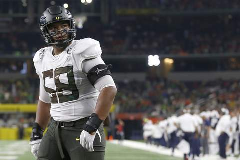 Virus Outbreak College Sports Football FILE - In this Aug. 31, 2019, file photo, Oregon offensive lineman Penei Sewell (58) looks on as Oregon plays Auburn in an NCAA college football game in Arlington, Texas. (AP Photo/Ron Jenkins, File) (Ron Jenkins