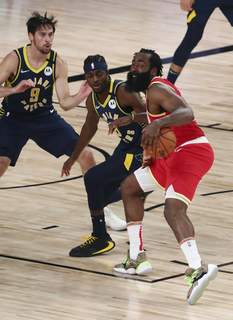 Pacers Rockets Basketball Associated Press Rockets guard James Harden, who scored 45 points Wednesday, is defended by Pacers guard T.J. McConnell, left, and forward Justin Holiday in Lake Buena Vista, Fla. (Kim KlementPOOL)