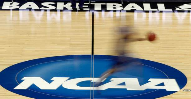 Supreme Court NCAA FILE - In this March 14, 2012, file photo, a player runs across the NCAA logo during practice in Pittsburgh before an NCAA tournament college basketball game. (AP Photo/Keith Srakocic, File) (Keith Srakocic