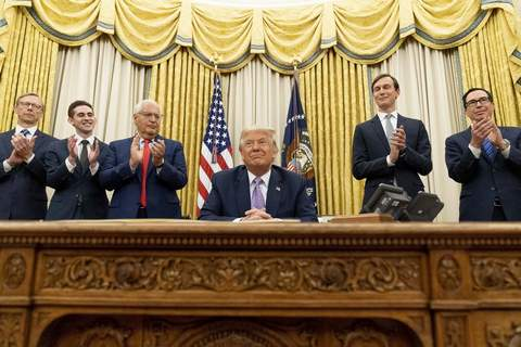 President Donald Trump, accompanied by F=from left, U.S. special envoy for Iran Brian Hook, Avraham Berkowitz, Assistant to the President and Special Representative for International Negotiations, U.S. Ambassador to Israel David Friedman, President Donald Trump's White House senior adviser Jared Kushner, and Treasury Secretary Steven Mnuchin, applaud in the Oval Office at the White House, Wednesday, Aug. 12, 2020, in Washington. (AP Photo/Andrew Harnik)
