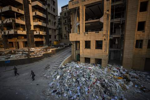 Lebanon Explosion People walk next debris from destroyed buildings near the site of last week's explosion that hit the seaport of Beirut, Lebanon, Wednesday, Aug. 12, 2020. (AP Photo/Hassan Ammar) (Hassan Ammar STF)