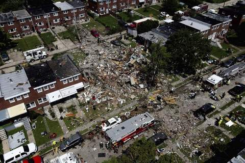 APTOPIX Baltimore Explosion Debris and rubble covers the ground in the aftermath of an explosion in Baltimore on Monday, Aug. 10, 2020.  (AP Photo/Julio Cortez) (Julio Cortez