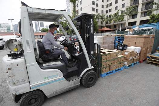US Productivity In this Wednesday, June 3, 2020 photo, a manager at the Presidente Supermarket uses a forklift to move a shipment of food at the store in the Little Havana neighborhood of Miami. U.S. productivity fell at a 0.9% rate in the first three months of this year, a smaller decline than first estimated, while labor costs rose at a slightly faster pace. The Labor Department reported Thursday that the first quarter decline in productivity was smaller than the initial estimate a month ago of a 2.5% drop. Labor costs rose at a 5.1% rate, slightly faster than the 4.8% increase first reported.(AP Photo/Wilfredo Lee) (Wilfredo Lee