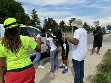 Jamie Duffy | The Journal Gazette Milwaukee activist Frank Nitty II autographs the T-shirt of Fort Wayne resident Tykisha Vaughn on Friday on Maumee Avenue as his group continues its march  to Washington, D.C.