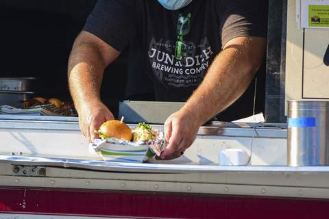 Photos by Mike Moore | The Journal Gazette Local food trucks have taken their mobile restaurants to the neighborhoods, such as this food rally at Redeemer Lutheran Church along Rudisill Boulevard, in an effort to drum up more business during the pandemic.