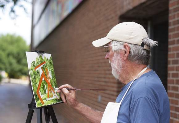 Katie Fyfe | The Journal Gazette Jerry Hertenstein from Fort Wayne paints a sculpture in Freimann Square for the Kekionga Plein Air Event on Saturday, August 29th, 2020.