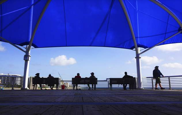 Associated Press People on Wednesday visit a pier in Pompano Beach, Fla., ahead of Labor Day weekend.