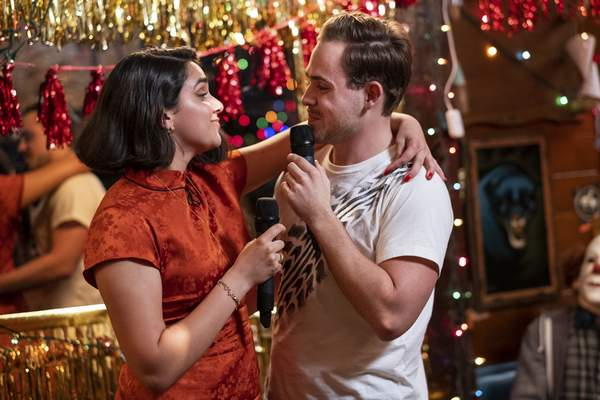 This image released by Sony -TriStar Pictures shows Geraldine Viswanathan, left, and Dacre Montgomery in a scene from The Broken Hearts Gallery. (George Kraychyk/Sony-TriStar Pictures via AP)